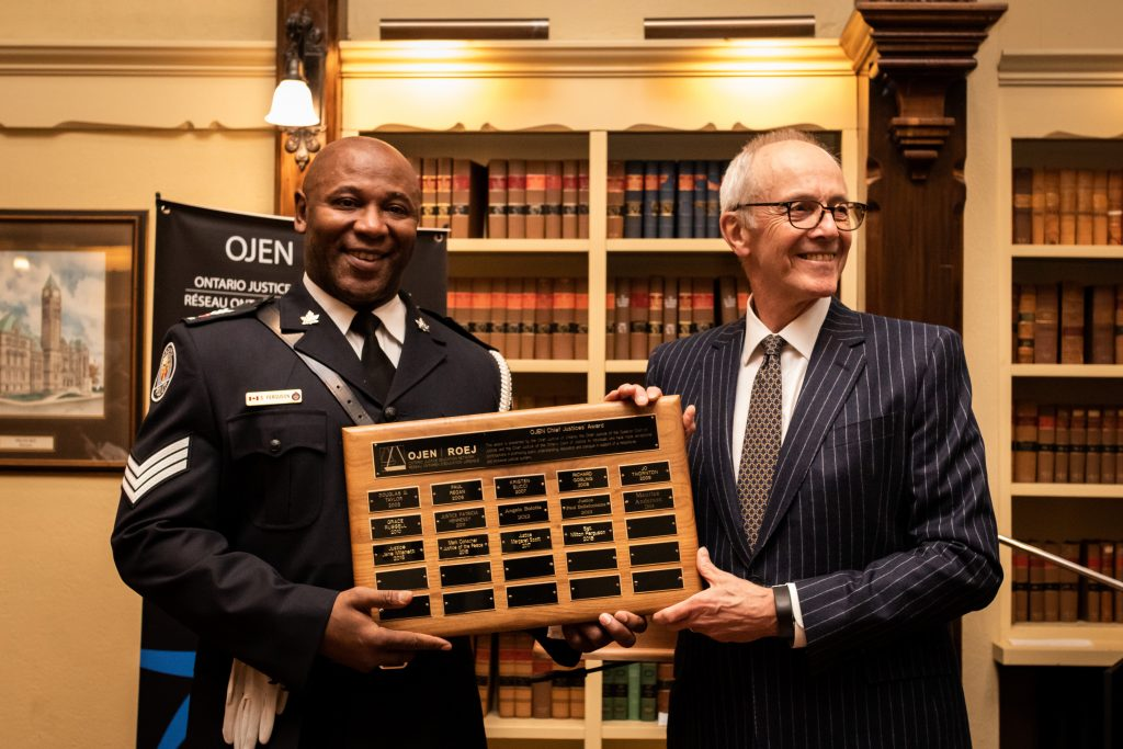 Sergeant Milton Ferguson receiving the Chief Justices' Award presented by the Honourable George R. Strathy